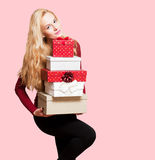 Blond christmas beauty. Portrait of a blond Christmas beauty holding gift boxes Stock Photo