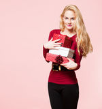 Blond christmas beauty. Portrait of a blond Christmas beauty holding gift boxes Stock Image