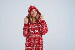 Blond in christmas pajamas smiling. Isolated on white Stock Image