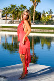 Blond in coral dress. Royalty Free Stock Photo