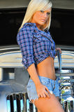 Blond country girl in front of classic auto Stock Photo