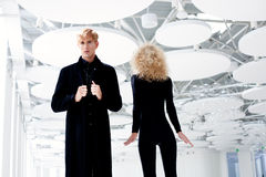 Blond couple classic secret agent and girl Stock Images