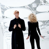 Blond couple classic secret agent and girl Stock Image