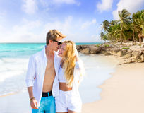 Blond couple walking in tropical Caribbean beach Royalty Free Stock Photography