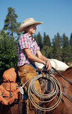 Blond Cowgirl. Beautiful blond cowgirl happy to be riding her horse stock image