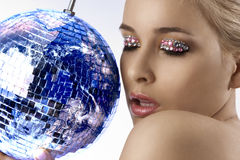 Blond with creative make up an shining ball Royalty Free Stock Image