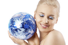 Blond with creative make up an shining ball Stock Photos