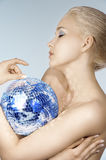 Blond with creative make up an shining ball Royalty Free Stock Photos