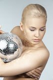 Blond with creative make up an shining ball Royalty Free Stock Photo