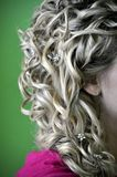 Blond Curls. Closeup of woman with beautiful blond curls royalty free stock photo