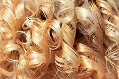 Blond curly hair. Blond human curly hair background royalty free stock photography