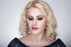 Blond curly woman Royalty Free Stock Photography