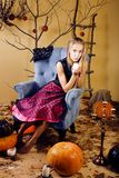 Blond cute girl in halloween interior Royalty Free Stock Image