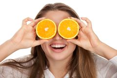 Blond and cute girl with orange Stock Images