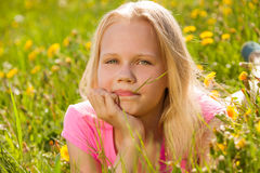 Blond cute girl in yellow flowers portrait Royalty Free Stock Photography