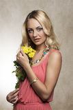 Blond cute summer girl with flowers Royalty Free Stock Images