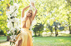 Blond cutie swinging on the seesaw Royalty Free Stock Photo
