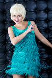 Blond dancing woman in green dress Royalty Free Stock Photo