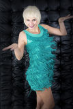 Blond dancing woman in green dress Stock Images