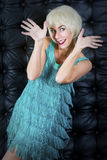 Blond dancing woman in green dress Stock Image