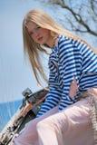 Blond dans le bateau Photographie stock libre de droits