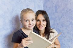 Blond daughter with brunette mother royalty free stock photo