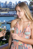 Blond drinking champagne. On the balcony 2 stock photography