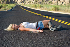 Blond drunk on highway stock photography