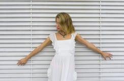 Blond dziewczyna z białą suknią w białym tle Obraz Royalty Free