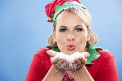 Blond elf female blowing snow Royalty Free Stock Photos