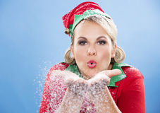 Blond elf female blowing snow Royalty Free Stock Image