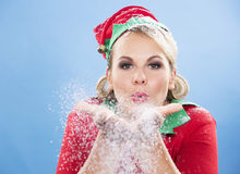 Blond elf female blowing snow Stock Image