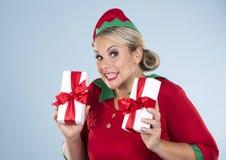 Blond elf female holding present Stock Images