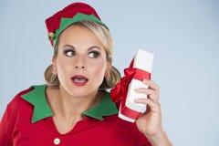 Blond elf female holding present Stock Image