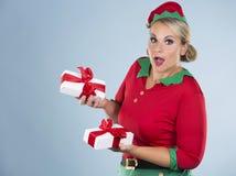 Blond elf female holding present Stock Photos