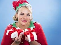 Blond elf female holding present Royalty Free Stock Image