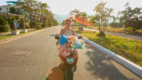 Blond European Girl Rides Motorcycle along Street stock footage