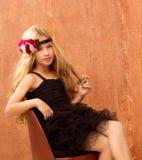 Blond fashin kid girl on retro vintage seat Stock Images