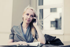 Blond fashion business woman calling on cell phone Royalty Free Stock Photo