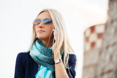 Blond fashion business woman calling on cell phone outdoor Stock Images
