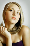Blond Fashion Girl. Blonde Hair. Golden tones Royalty Free Stock Photos