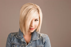 Blond fashion model. Trendy fashion model with attractive hair style Stock Image