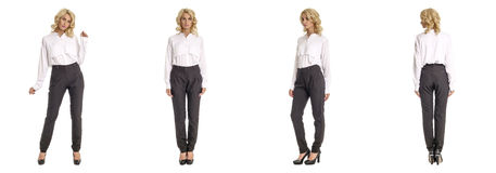 Blond fashion model in black trousers isolated over white. Blond fashion model in black trousers isolated stock images