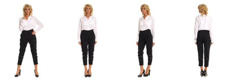 Blond fashion model in black trousers isolated over white. Blond fashion model in black trousers isolated stock photo