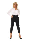 Blond fashion model girl stand in black trousers isolated. Blond fashion model girl stand in black trousers stock images