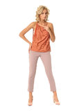 Blond fashion model girl stand in pink trousers isolated. Blond fashion model girl stand in pink trousers Royalty Free Stock Photos