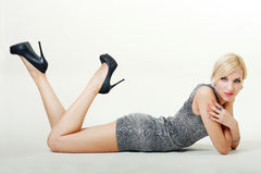 Blond fashion model laying on floor Stock Image