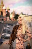 Blond fashion model russian girl close up photo on red square ba royalty free stock photo