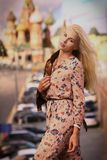 Blond fashion model russian girl close up photo on red square ba stock photos