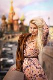 Blond fashion model russian girl close up photo on red square ba stock image